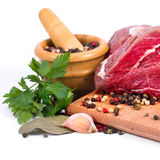 Crude meat and spice Stock Photos