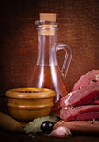 Crude meat and spice on white background Stock Images