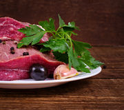 Crude meat and spice Stock Images