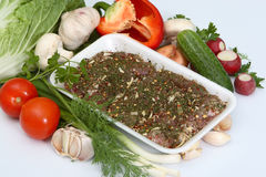 Crude meat with vegetables and seasoning Stock Photography