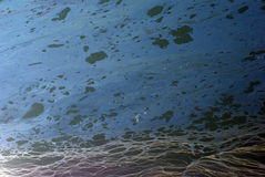Crude oil ontop of seawater Stock Photo