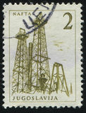 Crude Oil Production. RUSSIA KALININGRAD, 12 NOVEMBER 2016: stamp printed by Yugoslavia, shows Crude Oil Production, circa 1958 Royalty Free Stock Photo