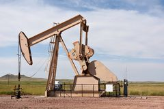 Crude oil production well site pump jack and fields in the Niobrara shale. Of Wyoming, USA stock image