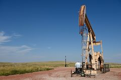 Crude oil production well site pump jack and fields in the Niobrara shale. Of Wyoming, USA stock photography