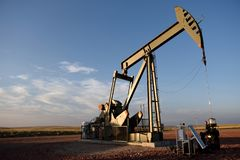 Crude oil, pump jack, Niobrara shale, copy space. Crude oil production well site pump jack and fields in the Niobrara shale of Wyoming, USA royalty free stock images