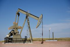 Crude oil production well site pump jack and natural gas flare in the Niobrara shale. Of Wyoming, USA royalty free stock photo