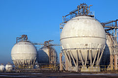 Crude oil storage tanks in oil refinery backyard Royalty Free Stock Photography