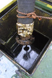 Crude oil in tank. Crude oil being pumped into tank after leak Stock Image