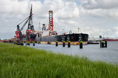 Crude oil tanker anchored in harbor Rotterdam, Netherlands. Royalty Free Stock Photo