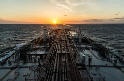 Crude oil tanker is proceeding through ocean in the morning. Stock Photo