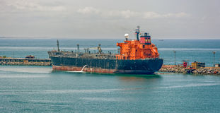 Crude oil tanker. Pumping ballast water in Lagos, Nigeria, Africa Stock Photo