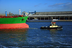 Crude oil tanker and tug Stock Photo