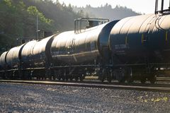 Crude oil transportation in black wagons stock photo