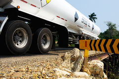 Crude oil truck tanker. Truck transporting crude oil passes over a bridge in Belize Royalty Free Stock Image