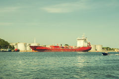 Crude red oil tanker loading in the port. Crude oil tanker is loading in the port Stock Photos
