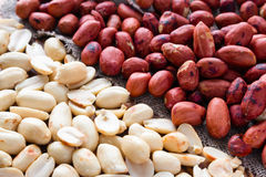 Crude and refined roasted peanuts Stock Photos