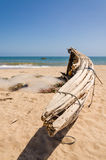 Crude wooden fishing boat lying on yellow beach near Lobito, Angola. Crude wooden fisher boats lying on yellow beach near Lobito, Angola. These boats have been Royalty Free Stock Photos