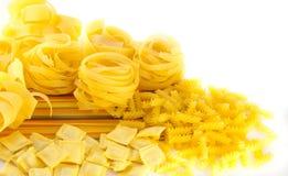 Crude yellow macaroni Stock Photos