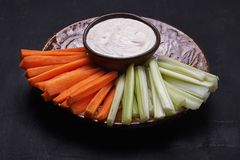 Crudites. carrot and celery. On a plate with dip Royalty Free Stock Images