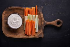 Crudites. carrot and celery. On a plate with dip Royalty Free Stock Photos