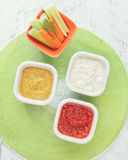 Crudites with dip. Vegetable sticks with three different  dips Royalty Free Stock Photos