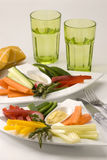 Crudites salad. Assorted vegetables sticks and dips in white plates. Selective focus Stock Photos