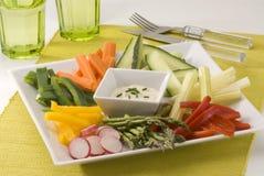Crudites salad. Assorted vegetables sticks and dip. Selective focus Stock Photo