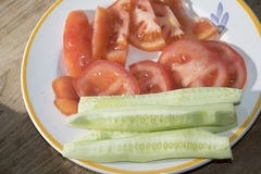 Crudites of vegetables. With slices of tomatoes and cucumbers Stock Photos