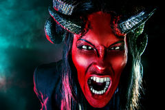 Cruel evil. Portrait of a devil with horns. Fantasy. Art project Stock Photography