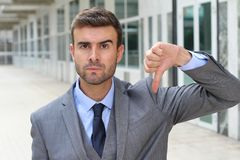 Cruel man giving a solid thumbs down.  Stock Image