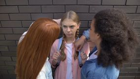 Cruel schoolgirls pushing younger teenager against wall, psychological pressure. Stock footage stock footage