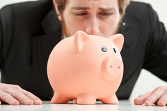 Cruel world, piggybank have to be sacrificed Stock Photo
