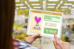 Cruelty free concept, girl holds the digital tablet on blurred shop background. Cruelty free concept, girl with tablet pc on blurred shop background royalty free stock images