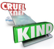 Cruelty Vs Kindness Words Balance Cruel or Kind. The words Cruel and Kind on a balance or see-saw to illustrate the difference in demeanor between cruelty and Stock Image