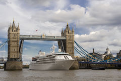 Cruiise ship passing Tower bridge in London Royalty Free Stock Images
