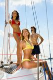 Cruise. Portrait of three happy people having a rest on a yacht Stock Photography