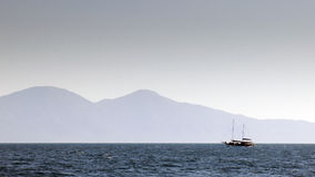 Cruise in the Aegean. A sailboat is on a cruise in the Aegean Sea, of the coast of Kusadasi in Turkey Royalty Free Stock Images