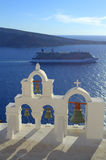 Cruise and bell tower in Oia,Santorini Royalty Free Stock Images