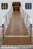 Cruise boarding entrance platform. In sea port. Vertical close up view Stock Image