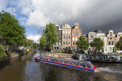 Cruise boat at Amsterdam canal Stock Images