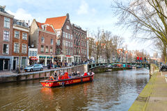 Cruise boat at Amsterdam canals in Holland, street view Stock Images