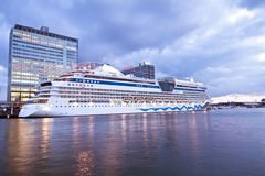 Cruise boat in Amsterdam harbor in the Netherlands Stock Photo