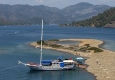 A cruise boat anchored to a small beach in the Mediterranean Sea off the Turquoise Coast of Turkey. Royalty Free Stock Photo