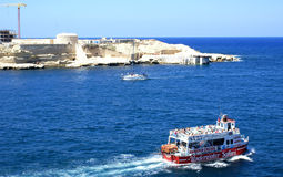 Harbour Cruise boat. A ferryboat in the Valletta harbour, with tourist Malta Royalty Free Stock Photos