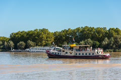 Cruise boat on Garonne river in Bordeaux, France Stock Images