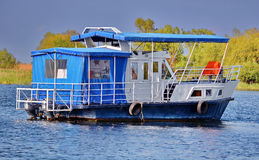 Cruise boat. Little one day cruise boat on Danube Delta Stock Photos