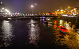 Cruise boat in night canals of Amsterdam. Stock Photo