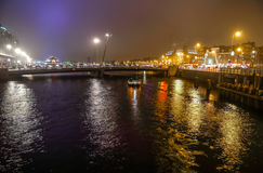 Cruise boat in night canals of Amsterdam. Royalty Free Stock Photography