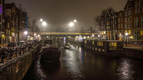 Cruise boat in night canals of Amsterdam. Royalty Free Stock Photo