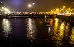 Cruise boat in night canals of Amsterdam. Royalty Free Stock Images